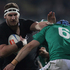 Kieran Read of the All Blacks fends off Kevin McLaughlin of Ireland during the International Test Match between New Zealand and Ireland. Photo / Getty Images.