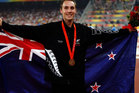 Nick Willis of New Zealand poses after winning a bronze medal in the men's 1500m at the Beijing 2008 Olympic Games. Photo / Getty Images.