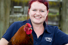 Gina Kemp from SPCA Auckland with Magnum a silky-cross Rooster. Photo / Richard Robinson