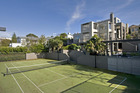 The property at 43 St Stephens Ave, withits Hobson Bay view and the all-weather tennis court. Photo / Supplied