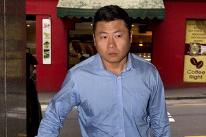 Hui Leo Gao arrives at the Auckland District Court ahead of his guilty plea to seven charges. Photo / NZ Herald