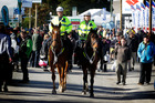 Police officers Bill and Karen Eivers are on horseback during the Fieldays at Mystery Creek. Photo / Christine Cornege