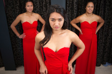 Mount Albert Grammar students Idoho Purcell, 17, Negin Shademan, 17, and Ashleigh Curtis, 18, try on ball dresses at Affordaball Dresses in Mt Roskill. The store keeps a register to avoid duplicating dresses at a school ball. Photo / Greg Bowker
