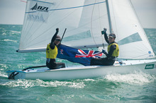 Jo Aleh and Olivia Powrie celebrate retaining their crown in the 470 event at Weymouth last week. Photo / Supplied.