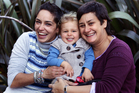 Janine Chester and Anja Otto with their daughter, Tia Chester-Otto. Photo / Doug Sherring