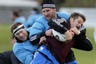 Richie McCaw is tackled by Wyatt Crockett and Kieran Read during an All Blacks training session. Photo / Getty Images