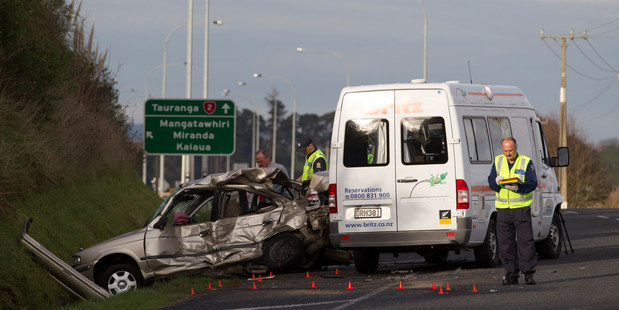 Police investigate the scene of a serious crash that left two people dead on State Highway Two near Mangatawhiri on Friday afternoon. Photo / Greg Bowker