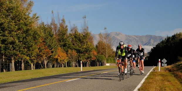 Riders sweat it out on the picturesque Tuakau to Raglan leg of the Cycle Tour of NZ. Photo / Supplied