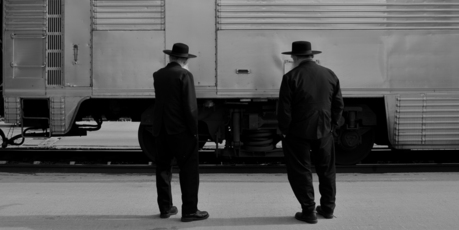 Two Amish men and a train at Albuquerque Station. Photo / Creative Commons image by Rob Sinclair