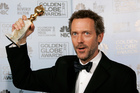 Hugh Laurie with the Golden Globe he won for best actor in a drama series for his work 'House'. Photo / AP