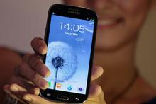 A model displays a Samsung Galaxy S III. Photo / AP