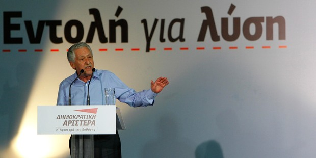 Financial markets are awaiting Greece's second general election this weekend. Democratic Left leader Fotis Kouvelis speaks to his supporters during an election rally in Athens yesterday. Photo / AP