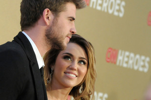Liam Hemsworth, left, and actress and singer Miley Cyrus. Photo / AP
