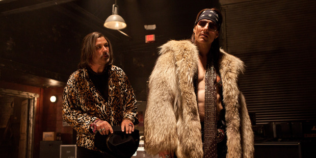 Tom Cruise shines as hair metal god, Stacee Jaxx, here with Alec Baldwin (left) as club owner, Dennis. Photo / Supplied