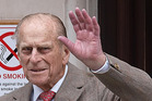 Prince Philip, Duke of Edinburgh waves as he leaves King Edward VII Hospital in central London. Photo/ AP