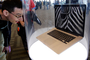An attendee looks at the new MacBook Pro on display at the Apple Developers Conference in San Francisco. Photo / AP