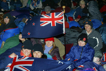 New Zealanders and Australians wait for dawn to break at the 90th anniversary commemorations of the Gallipoli landings in 2005. Photo / Mark Mitchell