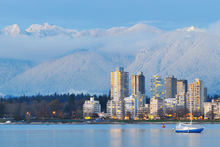 Vancouver's Grouse Mountain is seen in the background, beyond the city centre. Photo / Thinkstock