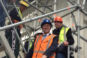 Prime Minister John Key at Old St Paul's Cathedral in Wellington inspects the work of young workers employed using a Government subsidy scheme after announcing a new scheme. Photo / Claire Trevett