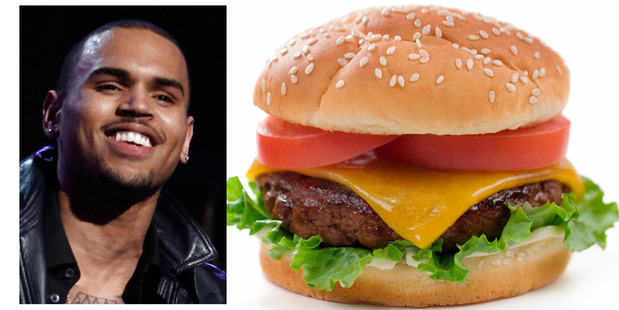 Velvet Burger, which has stores in Auckland and Dunedin, advertised a 'smashing good deal' with an accompanying logo saying 'Beatings by Chris Brown'. Photos / File