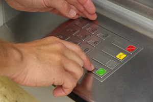 A care worker and her partner used a 99-year-old woman's bank card to fleece $37,500. File photo / Thinkstock