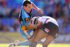 Greg Bird of the Titans is tackled.  Photo / Getty Images