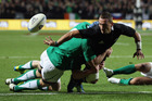 Aaron Cruden of the All Blacks offloads the ball. Photo / Getty Images