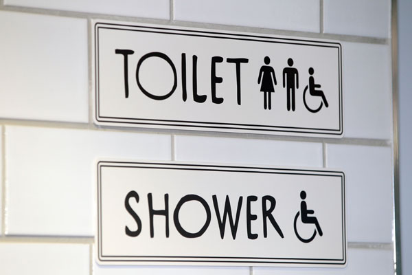 Pictured is a Toilet and Shower sign at Auckland's iconic Tepid Baths. The renovated swimming complex and Gymnasium  is set to re-open to the public on Saturday June 23 2012.  The Tepid baths have been closed since early 2010.