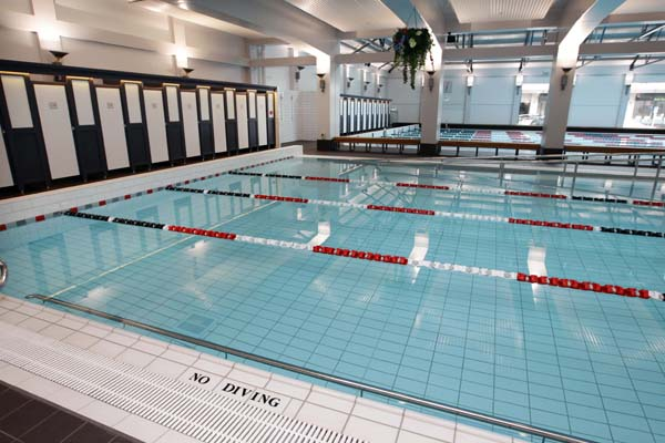 Pictured is the main swimming pool area in Auckland's renovated iconic Tepid Baths.  Also shown are hanging baskets which have been copied from photographs of the original baths, and poolside changing rooms. The swimming complex and Gymnasium  is set to