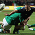 Aaron Cruden of the All Blacks offloads the ball during the International Test Match between New Zealand and Ireland. Photo / Getty images.