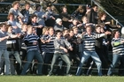 Students at a previous Christ's College vs Christchurch Boys' High School rugby match.
