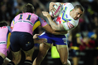Blake Ferguson of the Raiders is tackled by Kane Linnett and Gavin Cooper of the Cowboys. Photo / Getty Images.