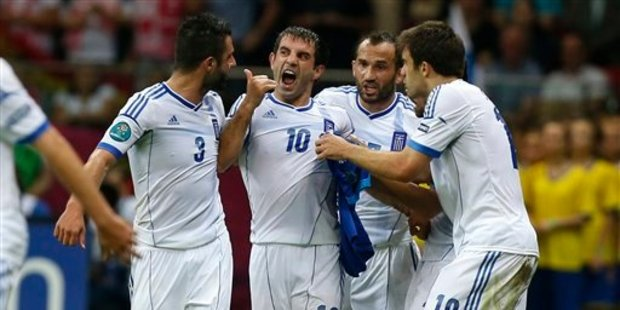Greece's Giorgos Karagounis celebrates after scoring a goal. Photo / AP