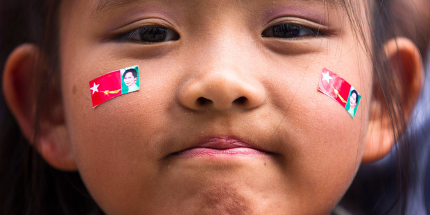 A girl with pictures of Myanmar opposition leader Aung San Suu Kyi stickers on her face attend a concert to honor Suu Kyi after her speech at the Peace Nobel Prize lecture at the city hall in Oslo.  Photo / AP