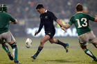 Dan Carter attempts a drop kick, but was charged down. Photo / Getty Images.