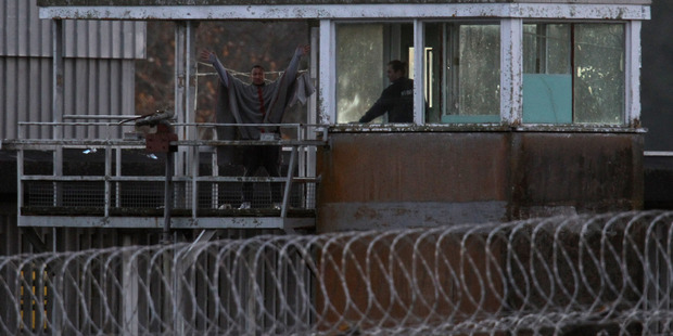 Notorious escaper and fellow inmate pose no threat to the community, say Corrections officials The disused security tower at Paremoremo has been cordoned off since the two prisoners were spotted. Picture / Getty Images.