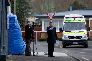 Investigators at the entrance to the driveway (rear) where 57-year-old Jordan Voudouris was found dead yesterday.  Photo / Christine Cornege