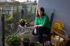 Student Jennifer Parlane with her garden balcony in inner-city Auckland. Photo / NZ Herald