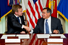 Defence Minister Jonathan Coleman and US Secretary of Defence Leon Panetta (right) seal the new agreement in Washington. Photo / Supplied
