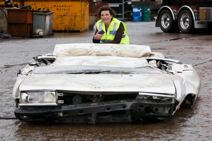 Police Minister Anne Tolley inspects the Nissan Laurel after it was crushed in Lower Hutt yesterday. Photo / Mark Mitchell