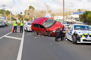 Police investigate the crash scene on Great South Rd in Manurewa yesterday.