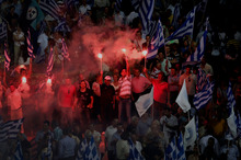 New Democracy party supporters at a final rally before elections today.  Photo / Petros Giannakouris