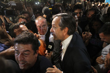 Leader of the New Democracy conservative party Antonis Samaras surrounded by media. Photo / AP