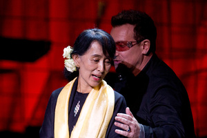 Aung San Suu Kyi with Bono after accepting her Ambassador of Conscience Award. Photo / AP