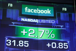 Investors sued Facebook and Nasdaq OMX Group over difficulties in trading company shares on May 18. Photo / AP
