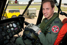 Britain's Prince William in the cockpit of a helicopter, earlier in June. The Prince celebrates his 30th birthday, and is set to inherit from his mother, Diana. Photo / British Defence Ministry