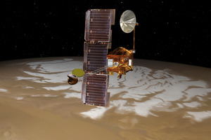 The Mars Odyssey spacecraft passes above Mars' south pole. Photo / Supplied