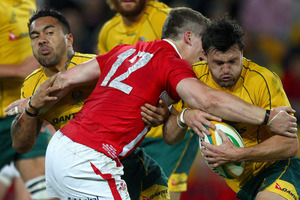 Wales' Scott Williams, center, wraps up Australia's Adam Ashley-Cooper, right, and Digby Ioane. Photo / AP.