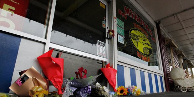 Locals have left notes and flowers at the Mykonos Pizza shop owned by Jordan Voudouris. File photo / Christine Cornege