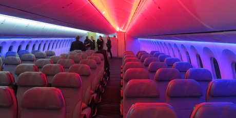 Boeing's 787 Dreamliner has electronic dimmable windows, vaulted ceilings, larger overhead compartments than other aircraft and mood lighting. Photo /  Grant Bradley